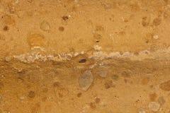 Detalle cerrado del ladrillo del fango Foto de archivo