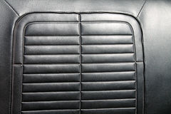 Detalle clásico de cuero negro del asiento de carro Imágenes de archivo libres de regalías