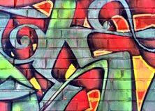 Detalle colorido de la pintada en una pared de ladrillo Imagen de archivo