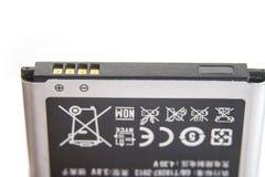 Detalle de contactos de una batería del smartphone en un blanco fotos de archivo