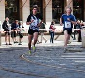 Detalle de corredores en el 5o kilómetro de PIM Foto de archivo