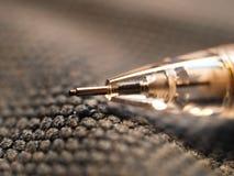 Detalle de lápices micro en un fondo de la materia textil Foto de archivo libre de regalías