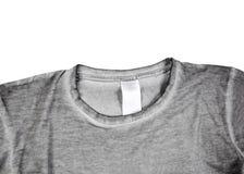 Detalle de la camiseta gris Fotos de archivo