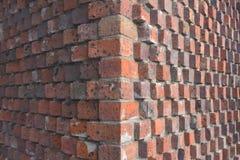 Detalle de la esquina de la pared de ladrillo roja foto de archivo