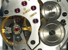 Detalle de la macro del reloj Fotos de archivo
