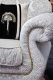 Detalle de la maneta y de la almohadilla del sofá Foto de archivo libre de regalías