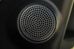 Detalle de la parrilla del altavoz del coche Foto de archivo libre de regalías