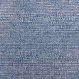 Detalle de la textura de la mezclilla del dril de algodón imagenes de archivo
