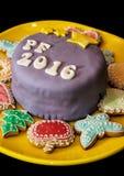 Detalle de la torta festiva con el título PF 2016 y el diverso jengibre Imagen de archivo