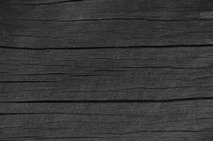 Detalle de madera de la textura de la pintura del alquitrán de madera del negro del tablero del tablón, viejo modelo macro rústic Fotos de archivo