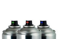 Detalle de tres latas del aerosol Foto de archivo libre de regalías