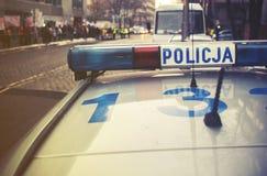 Detalle de un coche de Policja de la policía en Polonia, demostración en el CCB Foto de archivo libre de regalías