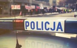 Detalle de un coche de Policja de la policía en Polonia, demostración en el CCB Imágenes de archivo libres de regalías