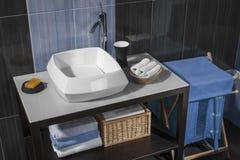 Detalle de un cuarto de baño moderno con el fregadero y los accesorios Imágenes de archivo libres de regalías