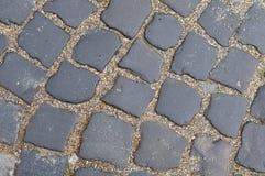 Detalle de un pavimento de la piedra del adoquín Imagen de archivo libre de regalías