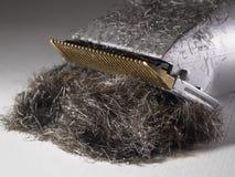 Detalle de un pelo/de un condensador de ajuste eléctricos modernos de la barba Imagen de archivo
