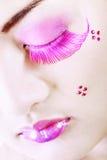 Detalle de una cara con maquillaje colorido Fotografía de archivo libre de regalías
