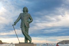 Detalle de una estatua de tamaño natural de bronce a Salvador Dali famoso en C imagen de archivo