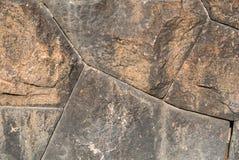 Detalle de una pared de piedra vieja en un día soleado Imagen de archivo libre de regalías