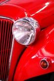 Detalle del coche histórico rojo Foto de archivo libre de regalías