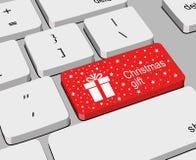 Detalle del teclado de ordenador con el regalo etiquetado dominante rojo de la Navidad y marcado con el icono blanco de las estre stock de ilustración