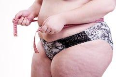 Detalle del tronco de una muchacha con obesidad Imagen de archivo