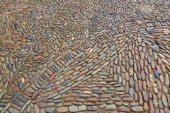 Detalle interesante de la calle con las piedras del guijarro Imagen de archivo libre de regalías