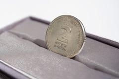 Detalle macro de una moneda del metal de dos shekels y x28; Nuevo shekel de la moneda israelí, ILS& x29; Fotografía de archivo libre de regalías