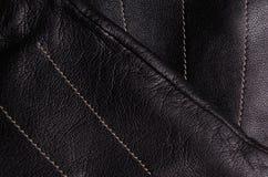 Detalle negro de los guantes de cuero Fotos de archivo