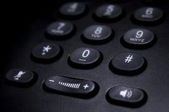Detalle negro del telclado numérico del teléfono imagenes de archivo