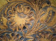 Detalle tallado leatherwork de Brown en la silla de montar Fotografía de archivo libre de regalías