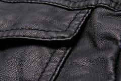 Detalles negros de la chaqueta de cuero Fotografía de archivo