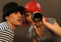 Detective. The couple is looking through spyglass Royalty Free Stock Photography