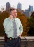 The Detective. A detective on his cell phone in the big city royalty free stock photography
