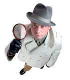 Detective 3. Man with magnifying glass Royalty Free Stock Images