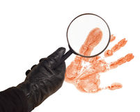 Detective. Hand of a detective with magnifier and trace stock photography