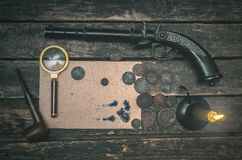 Detective agent table. Blank page document, magnifying glass, smoking pipe, musket and money on the detective spy agent table background stock images