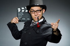 The detective in black coat with clapperboard Stock Images