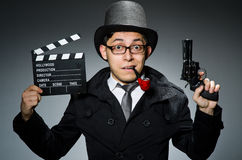 The detective in black coat with clapperboard Royalty Free Stock Photos
