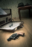 Detective briefcase on the floor Royalty Free Stock Images