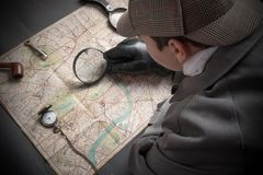 Detective with clock on chain. Detective man- magnifying glass, map of London, clock on chain royalty free stock photo