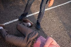 Detective at the crime scene. A man stands over the victim`s body. Crime. Murder outdoors royalty free stock photos