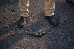 Detective at the crime scene. A man stands over the victim`s body. Crime. Murder outdoors royalty free stock images