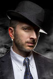Detective or Gangster in Smoky Noir Style Royalty Free Stock Image