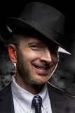 Detective or Gangster in Smoky Noir Style Stock Photography