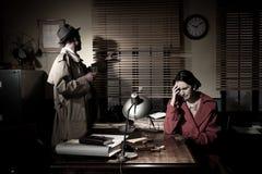 Detective giving bad news royalty free stock image