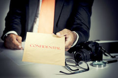 Detective. Giving a confidential envelope royalty free stock images