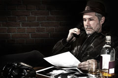 Detective in his office stock photo