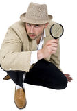 Detective and magnifier Royalty Free Stock Photography