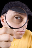 Detective with magnifier Royalty Free Stock Photos